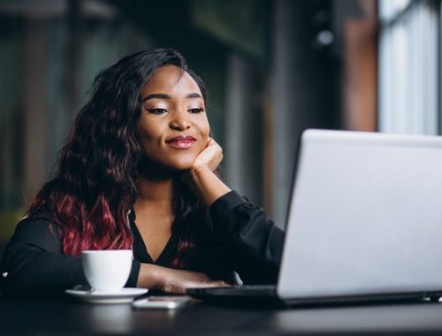 african-american-woman-with-laptop-coffee_1303-7296